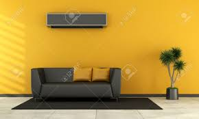 modern living room with black couch and air conditioner on wall