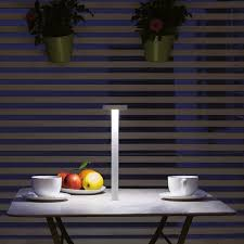 davide groppi tetatet is a portable lamp with magnetic base which