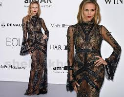 natasha poly black lace dress signed roberto cavalli with only a