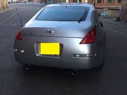Nissan 350z All Black - joy z i u0027ve got 99 problems but the nissan 350z ain u0027t one drivetribe