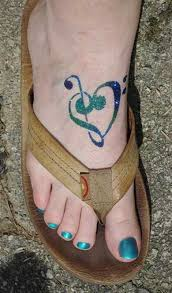 52 adorable musical note tattoo on foot