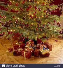 fashioned christmas tree fashioned christmas tree with decorations and presents stock