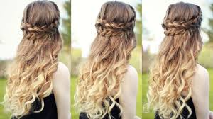 beautiful half down half up braided hairstyle with curls half