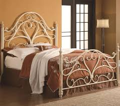 bedroom ideas wood floors with wrought iron headboard and bed frame