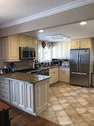 white kitchen cabinets with green granite countertops custom white wood kitchen cabinets complete stainless steel appliances kitchen aid granite countertop green kitchens