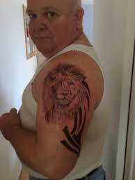 lion tribal head tattoo on biceps in 2017 real photo pictures