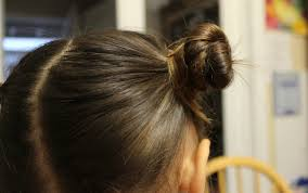hair buns for hair traditional children s hairstyle two buns on the sides