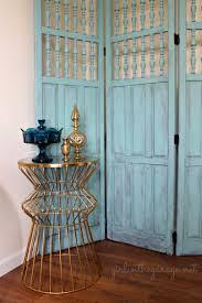 gold room divider makeover for a vintage room divider one artsy mama