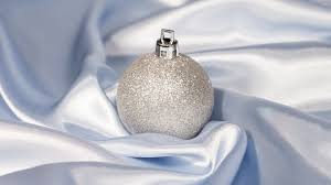 silver christmas bauble in silk wallpaper holiday wallpapers