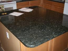 kitchen backsplash for black countertops lee valley cabinet