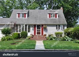 suburban cape cod style home landscaped stock photo 115712341