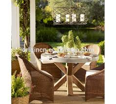 concrete top wooden round table 5 pieces wicker chairs outdoor