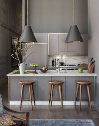 the subtle brass trim around this kitchen u0027s grey fittings add