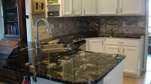 this kitchen remodel has 3cm titanium granite counters with a 2x4