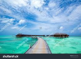 beach water bungalows maldives stock photo 548120296 shutterstock