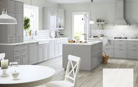 kitchen island wall cabinets a large grey country kitchen with a lot of drawers wall cabinets