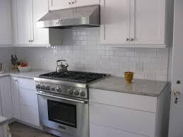 small white kitchen with white granite island u2014 smith design