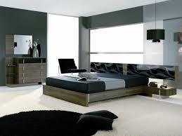 master bedroom black wooden bed with white brown bedding set dark