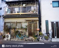 Modern Traditional House Two Bicycles Parked In Front Of Two Houses In Tokyo Modern And A