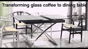 transforming small glass table turns into dining table by