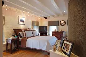 lighting on exposed beams light brown paint bedroom contemporary with exposed painted beams