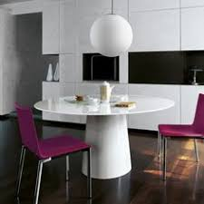 dining room with round white table neutral tufted chairs modern