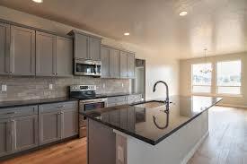 grey kitchen units with black granite worktops black granite grey cabinets wood floors brown