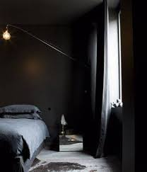 black walls in bedroom bedroom wall colors black walls masculine style with swing arm scone