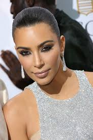kris jenner diamond earrings shines on cannes carpet in blinged up dress as