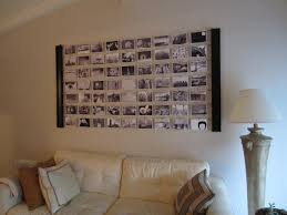 Black Leather Sofa With Cushions Black And White Pictures On The White Wall Combined With White