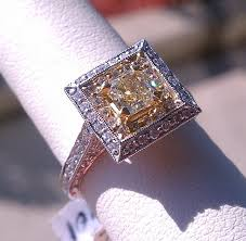 canary yellow engagement rings specials in the jewelers of grand blanc michigan
