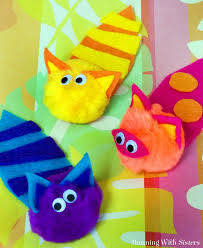 kid craft pompom cats running with sisters