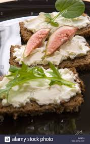 rye bread canapes pumpernickel rye bread canapes on a black plate stock photo