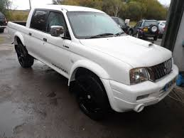 2004 mitsubishi l200 warrior white 3 months warranty 78k body