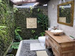 outdoor bathroom for pool glass shower in the near dark wooden