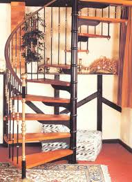 pleasant spiral staircase featuring natural varnished wooden