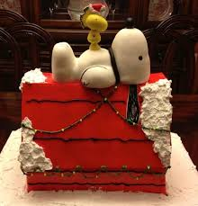 snoopy doghouse christmas decoration snoopy christmas doghouse cake between the pages