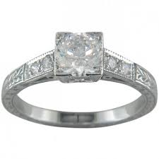 art deco engraved engagement ring with diamond set shoulders