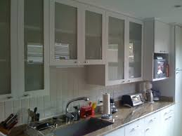 kitchen storage cabinets with glass doors floating white wooden cabinet with glass doors placed on the white
