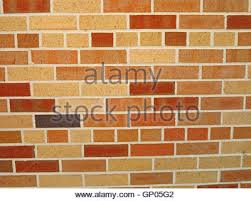 a brick wall with different color bricks stock photo royalty free