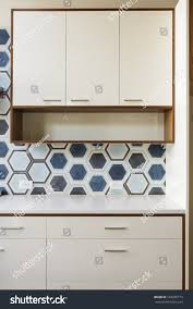white kitchen cabinets wood trim white kitchen cabinets wood trim hexagonal stock photo edit