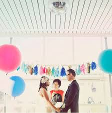 oversize balloons bring a bit of personality to your ceremony with bright punchy