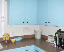 shabby chic painted kitchen cabinets with light blue tone mixed