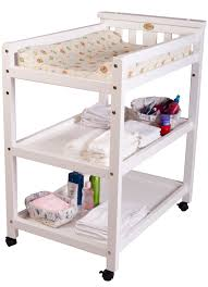 simple small wood baby bed with changing table and shelves painted