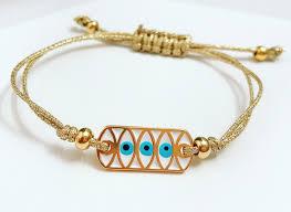 gold cord bracelet images Triple blue evil eye metallic gold cord bracelet jpeg