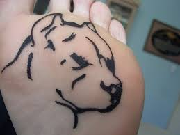 black pit bull dog head tattoo on under foot