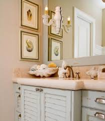 beach inspired bathroom ideas with unique wall sconce and cream
