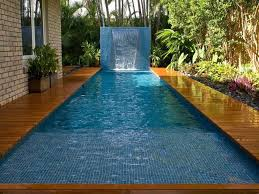 swimming pool with mosaic tiles and waterfall backyard swimming