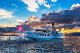 Blue Flag Yachts Ancien Steam Boat With Swiss Flag Floating On The Lake Geneva