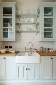 25 best butcher block countertops ideas on pinterest butcher palest blue kitchen cabinets topped with an apron sink and butcher block counters